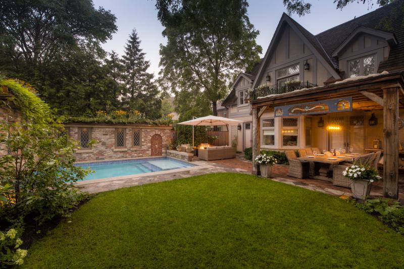 2017 - Residential Construction - $250,000 - $500,000 - The patios and walkways were built as those in the front, featuring reclaimed Credit Valley flagstone with a herringbone brick inlay.  The continuity works well.
