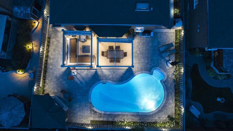 2017 - Landscape Lighting Design & Installation - Under $10,000 - Aerial bird's eye view of rear yard at night