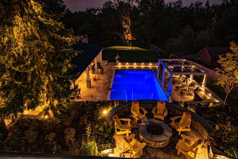 2018 - Landscape Lighting Design & Installation - Over $30,000 - Elevated Perspective capturing a completely lit up backyard