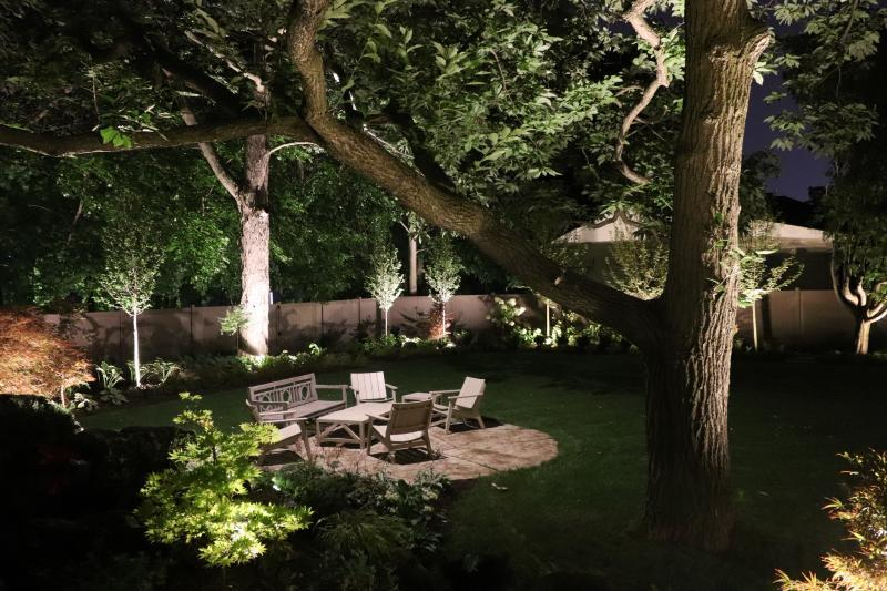 2019 - Landscape Lighting Design & Installation - $10,000 - $30,000 - down lighitng in the large chestnut tree were aimed directly at the patio.  uplights to shine into the canopy of the trees allowed this area to  become a wonderful destination in the evenings