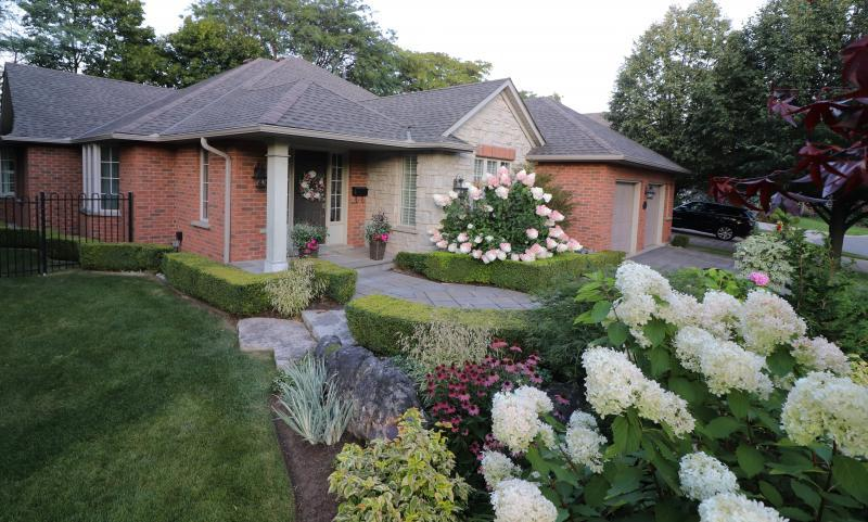 2019 - Residential Construction - $25,000 - $50,000 - new plant material and shape to  gardens as wel as new walkway
