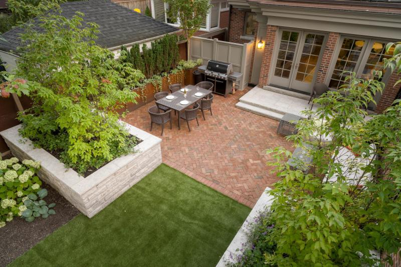 2019 - Residential Construction - $250,000 - $500,000 - The herringbone red brick echoes that of the front yard and contrasts nicely with the limestone landing and planter boxes.