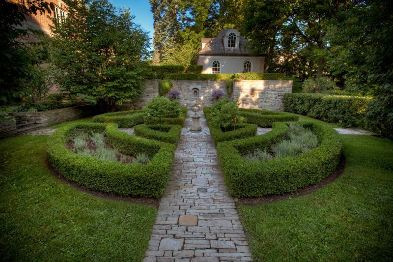 2019 - Private Residential Maintenance - 1 acre or more - The symmetry of the parterre is maintained through meticulous pruning of the boxwood hedging and hydrangea standards.  Lavender is mulched at the end of each season to provide winter protection.