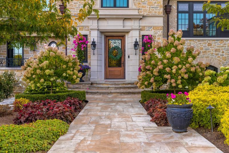 2019 - Residential Construction - $500,000 - $1,000,000 - Main entrance featuring a main walkway of square cut flagstone with landings and steps in the same material surrounded by lush planting with a touch of formality for the front entrance